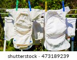 cloth diapers are drying in the ... | Shutterstock . vector #473189239