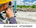 Surveyor Engineer Is Measuring...