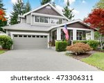 nice curb appeal of grey house... | Shutterstock . vector #473306311