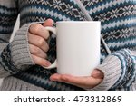 girl in a warm cardigan is... | Shutterstock . vector #473312869