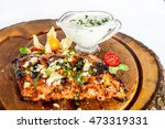 ribs with sauce on a wooden... | Shutterstock . vector #473319331