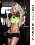 girl shows athletic body | Shutterstock . vector #473371585