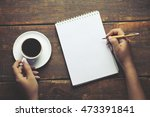 woman hand pen and coffee in... | Shutterstock . vector #473391841