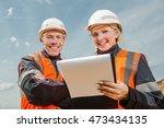 two people working   Shutterstock . vector #473434135