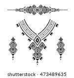 neckline is embroidered with a... | Shutterstock .eps vector #473489635