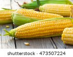 fresh corn on cobs on wooden... | Shutterstock . vector #473507224