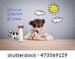 adorable baby girl holding... | Shutterstock . vector #473569129