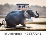 tourist watching an elephant... | Shutterstock . vector #473577241