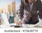 businesswoman working on desk... | Shutterstock . vector #473628775