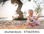 Baby Playing In Sand At Beach