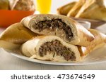 brazilian snack. meat esfiha on ... | Shutterstock . vector #473674549