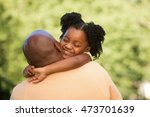 father hugging her daughter | Shutterstock . vector #473701639