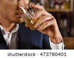 a drink for the man. cropped... | Shutterstock . vector #473780401