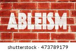 Small photo of Ableism Written On A Brick Wall