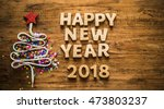 Small photo of Sigh symbol Christmas Tree from a lot colorful confetti, lace and red star toy on old retro vintage style wooden texture background Empty copy space for inscription Idea of merry new year 2018 holiday