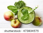 glass of green fruit and... | Shutterstock . vector #473834575