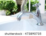 Water Drop From Chrome Faucet...