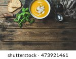 pumpkin cream soup in bowl with ... | Shutterstock . vector #473921461