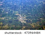 Aerial view of American Midwest Falls city Nebraska United States of America rural scenery with generic crops river airport roads detail exterior satellite landmark