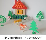 wooden house and plastic trees... | Shutterstock . vector #473983009