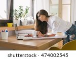 managing her business from home.... | Shutterstock . vector #474002545