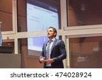 speaker giving talk on podium... | Shutterstock . vector #474028924