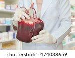 doctor holding fresh blood bag... | Shutterstock . vector #474038659