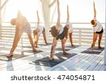 group of people practicing yoga ... | Shutterstock . vector #474054871