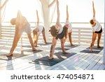 Group Of People Practicing Yog...