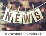"the word ""news"" stamped on... 