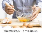 man whisking egg  in his...