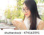 asian woman taking in smell of... | Shutterstock . vector #474163591