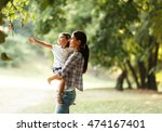 mother holding her daughter and ... | Shutterstock . vector #474167401