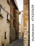 Small photo of Oct 5, 2007, San Gimignano, Italy. Alleyway with laundry and window planters