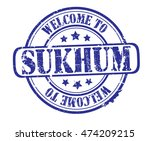 "rubber stamp with text ""welcome ... 