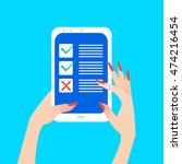 women's hand holding smart... | Shutterstock .eps vector #474216454