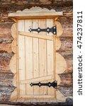 Wooden Door Of Log House Close...