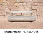 Wooden Bench Against A Stone...