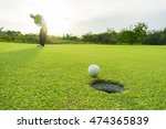 golfer putting golf ball on the ... | Shutterstock . vector #474365839