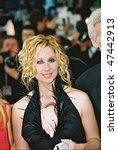 Small photo of CANNES, FRANCE - MAY 22: Singers Lara Fabian arrive to the closing night ceremony and the screening of 'De-Lovely' during the 57th Cannes Film Festival on May 22, 2004 in Cannes, France