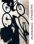 bike is casting shadows on the... | Shutterstock . vector #474430795