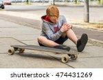 boy looking at his injured leg... | Shutterstock . vector #474431269