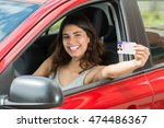smiling young woman showing her ... | Shutterstock . vector #474486367