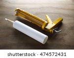 silicone gun on wooden... | Shutterstock . vector #474572431