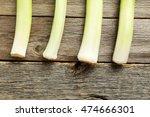 green leeks on a grey wooden... | Shutterstock . vector #474666301