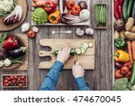 man cooking and slicing fresh... | Shutterstock . vector #474670045