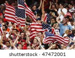 NUREMBERG, GERMANY - JUNE 22:  USA supporters celebrate a goal against Ghana during a 2006 FIFA World Cup soccer match June 22, 2006 in Nuremberg, Germany. - stock photo