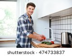 cheerful young man in checkered ... | Shutterstock . vector #474733837