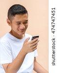asian boy using a smart phone. | Shutterstock . vector #474747451