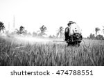 Small photo of Weed killer and pests killer with a man,farmer work hard in wide farm rice on sunshine day at Thailand on black and white color,Focus on a man